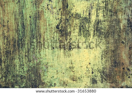 Rusty steel panel repainted in abstract black, yellow and green streaks.