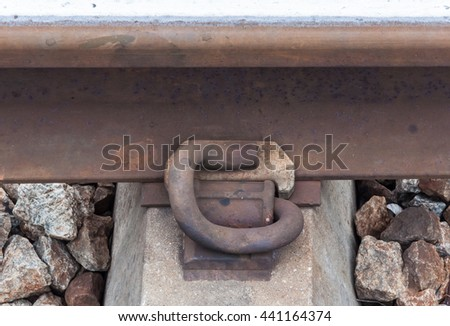 Rusty steel peg for attach the new rail and the concrete sleeper. - stock photo