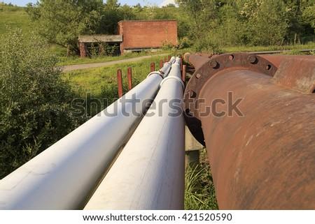 Rusty steel pipelines in grass field Rusty steel pipelines Rusty steel pipelines Rusty steel pipelines Rusty steel pipelines Rusty steel pipelines Rusty steel pipelines Rusty steel pipelines Rusty - stock photo