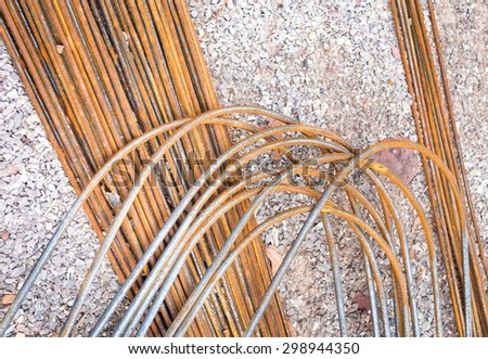 Rusty steel rods or bars used to reinforce concrete on the ground - stock photo