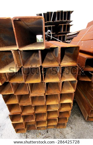 Rusty steel structure bunch on the rack in warehouse for raw material - stock photo