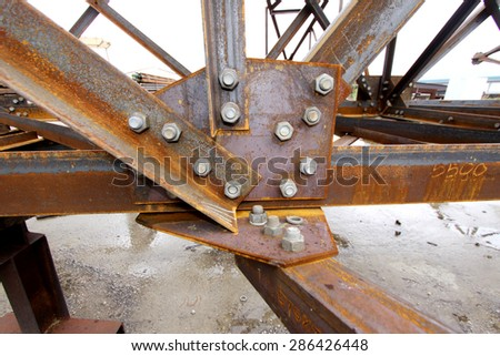 Rusty steel structure bunch on the rack in warehouse for raw material