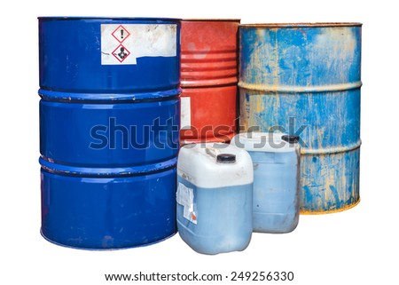Rusty toxic waste barrels isolated on a white background - stock photo