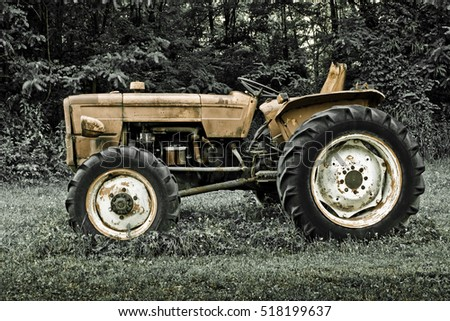 Rusty tractor abandoned in a field