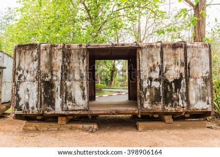 Rusty train bogie in Hellfire Pass that was used in the Death Railway construction during the World War II, Kanchanaburi, Thailand. - stock photo