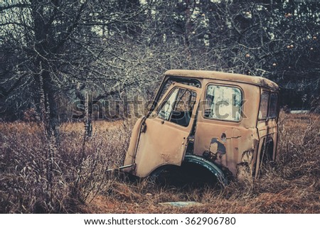 Rusty truck cab among the bare trees of November, the desolation, the exclusion zone, Chernobyl, Pripyat