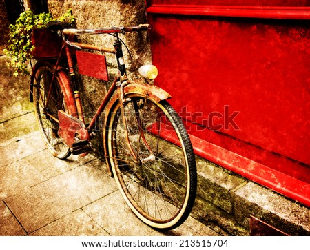 Rusty vintage red bicycle leaning with on red wooden board (useful for entering a text advertisement, menu etc) and carrying plants in wooden box as decoration. Retro aged photo with scratches. - stock photo
