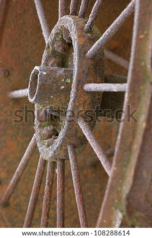 Rusty Wagon Wheel, antique, from the wild west ! - stock photo