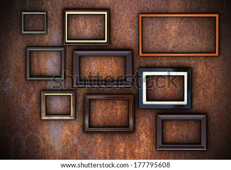 rusty wall full of empty frames ready for your design or message - stock photo