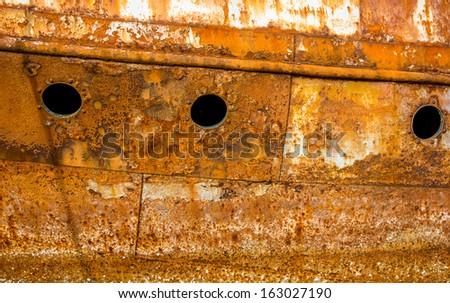 Rusty wall of an abandoned ship - stock photo