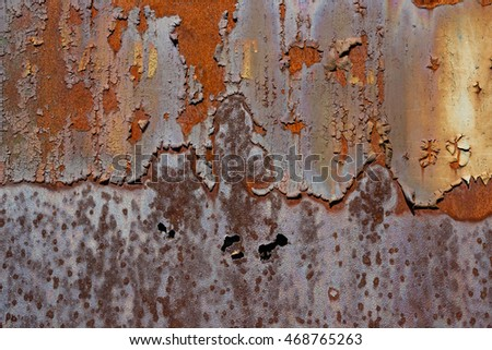 Rusty weathered iron (metal) with peeling paint.