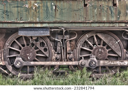Rusty wheels of abandoned train - stock photo