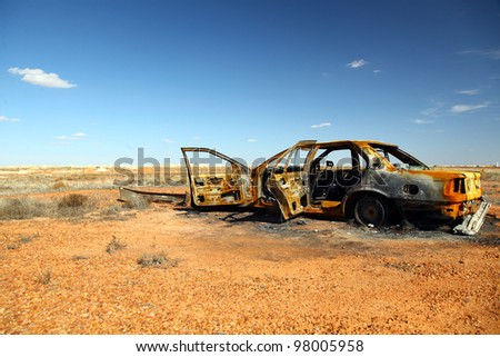 rusty wrecked car in Outback Australia - stock photo