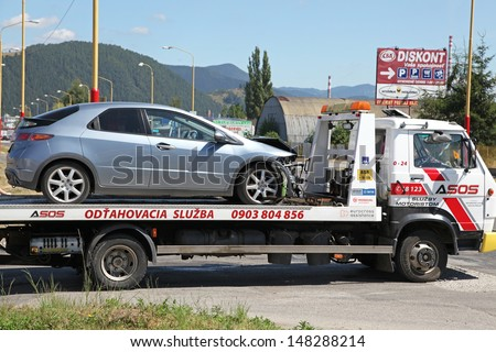 RUZOMBEROK - AUGUST 1: Wrecked car in the town on August 1, 2013 in Ruzomberok, Slovakia - stock photo