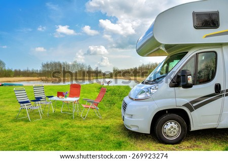 RV (camper) in camping, family vacation travel, holiday trip in motorhome  - stock photo