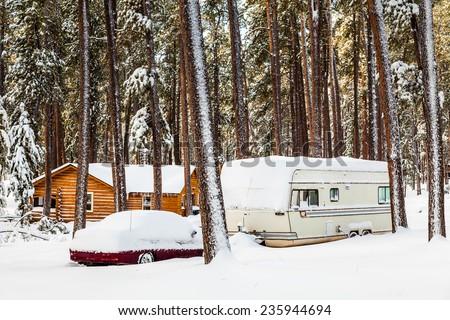 RV campsite in snow, Custer State Park, S. Dakota - stock photo
