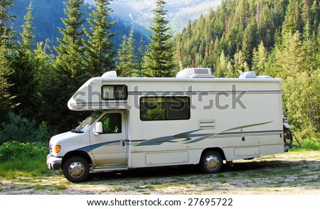 RV in the mountains - stock photo