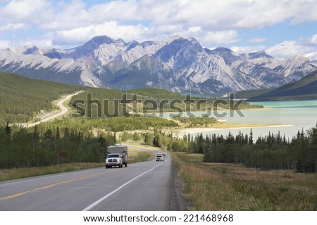 RV on a Winding Highway Next to a Mountain Lake in the Kootenay Plains - Alberta, Canada - stock photo