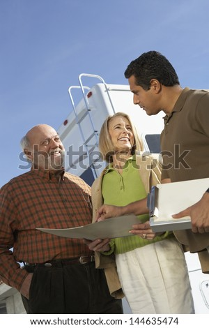 RV salesperson talking to customers low angle view - stock photo