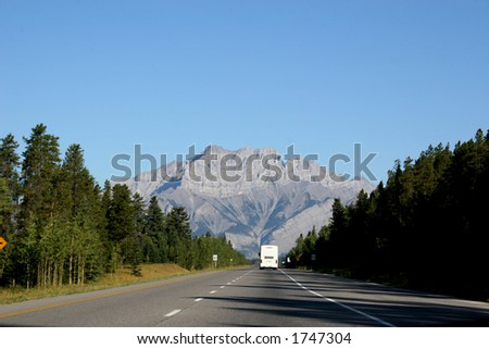 RV travelling through the mountains at Banff National Park, Alberta - stock photo