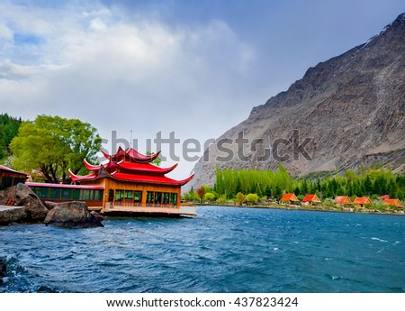 Rver flowing through the beautiful mountain valley in the northern part of the Karakorum mountains in Pakistan - stock photo