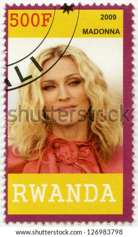 RWANDA - CIRCA 2009: A stamp printed in Republic of Rwanda shows Madonna Louise Ciccone, circa 2009 - stock photo
