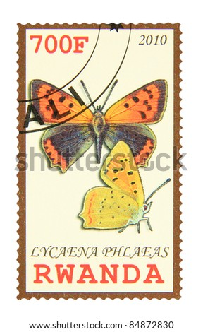 RWANDA - CIRCA 2010: A stamp printed in Rwanda showing Small Copper butterfly, circa 2010 - stock photo