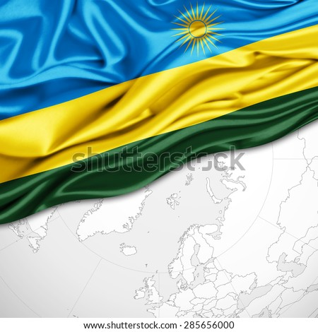 Rwanda flag of silk and world map background - stock photo