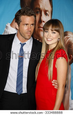 """Ryan Reynolds and Olivia Wilde at the Los Angeles Premiere of """"The Change-Up"""" held at the Westwood Village Theater in Los Angeles, California, USA on August 1, 2011.   - stock photo"""
