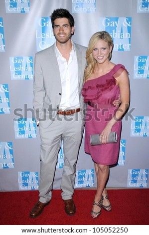 Ryan Rottman and Brittany Snow at 'An Evening With Women - Celebrating Art, Music and Equality'. Beverly Hilton Hotel, Beverly Hills, CA. 04-24-09 - stock photo