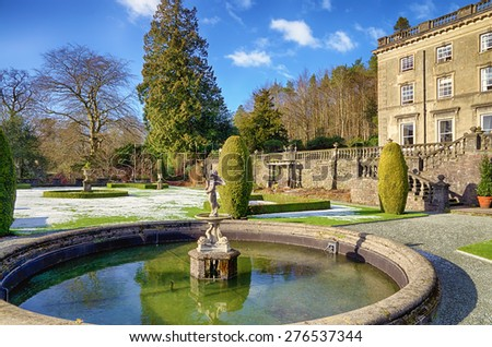 Rydal Hall and ornamental fountain on a frosty morning. - stock photo