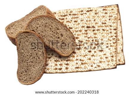 rye bread and matzo on white background - stock photo