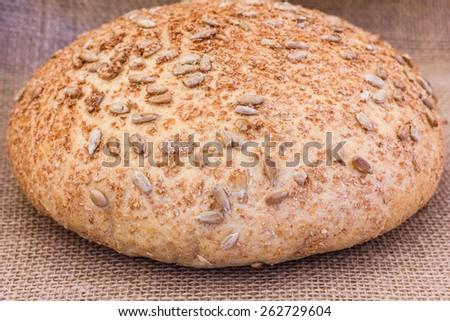 Rye bread on sackcloth closeup - stock photo
