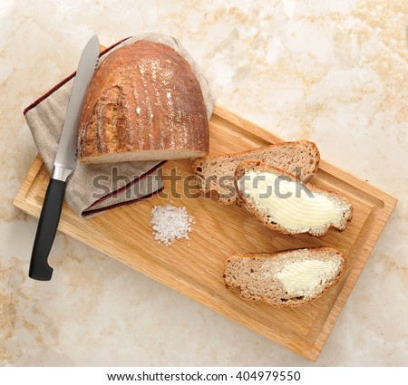 rye bread on the Board. bread cut into pieces and anointed with oil. the knife and wooden Board. top view - stock photo