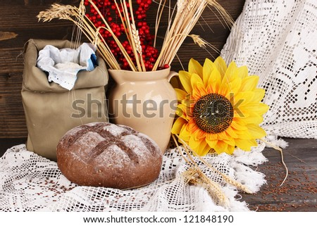 Rye bread on wooden table on autumn composition background - stock photo