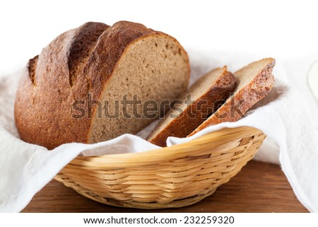 rye bread round black lying in a wicker basket