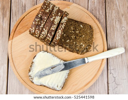 rye bread with butter on a cutting board