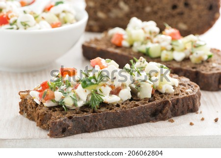 rye bread with cheese and vegetables, close-up, horizontal - stock photo