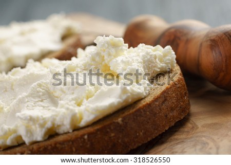 rye bread with cream cheese on wood table, rustic food