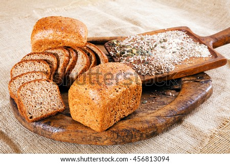 rye bread with seeds on a wooden plate