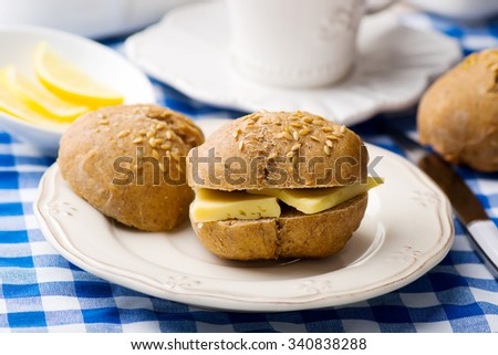 rye buns with cheese for a breakfast. style vintage. selective focus