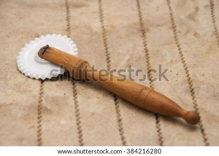 Rye dough, cutting round knife - stock photo