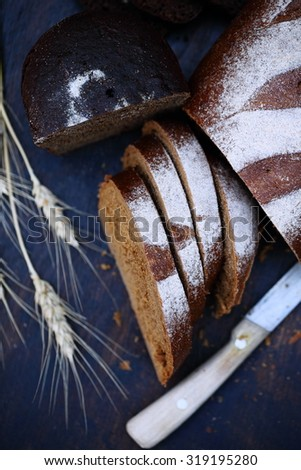 rye homemade bread and spikelets, rustic still life - stock photo
