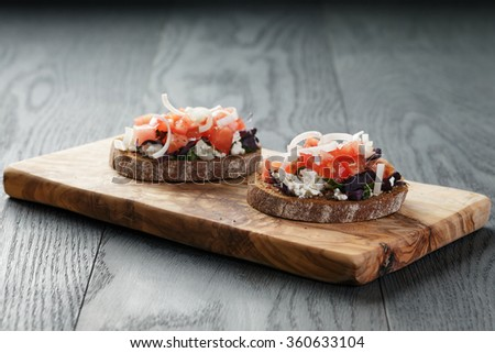 rye sandwich or bruschetta with ricotta, herbs and tomato - stock photo