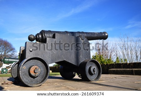 RYE, SUSSEX, UK - MARCH 7, 2015. A cannonball gun at Rye Castle, also known as Ypres Castle, which was built in 1249 as a defence against the frequently invading French, in Rye, Sussex, England, UK. - stock photo