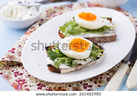 Rye toast sandwiches with egg and soft cheese, selective focus - stock photo