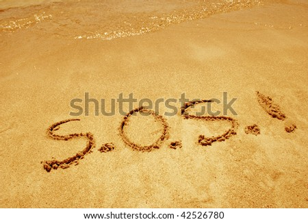 S.O.S. handwritten in sand for natural, symbol,tourism or conceptual designs