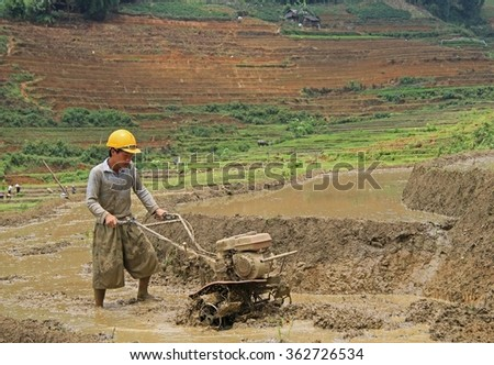 Sa Pa, Vietnam - June 6, 2015: man is working the soil by manual cultivator in village CatCat, Vietnam