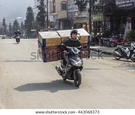 SA PA, VIETNAM - MARCH 12, 2016: A transport of heavy goods on a scooter at Sa Pa, Vietnam.