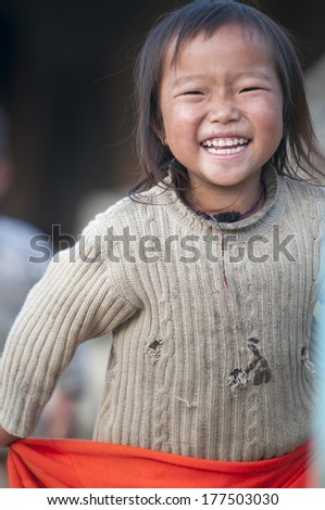 SA PA, VIETNAM - MAY 27, 2011: Unidentified smiling happy kid of Black Hmong ethnic minority tribe in Sa Pa, Northern Vietnam. - stock photo
